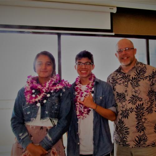 Melissa Kansou and Elijah Hu with Principal Joseph Halfmann of Pearl City High School