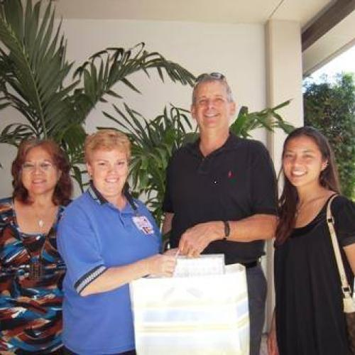 Charlene Mizumoto, Lisa Dau Coordinator of Kapiolani Hospital, Tim Dayton and Lee Yonaosi of GEICO.